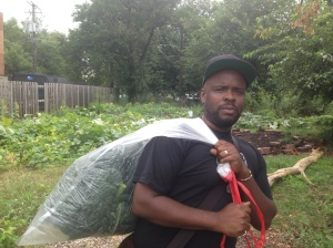 "Anton Seals Jr. is carrying a large bag of kale. We've affectionately named him  ""Kale Santa"""